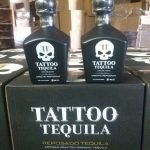 Tattoo Tequila Bottles on top of cases