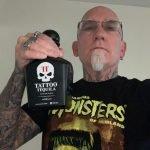 Tattoo Tequila Fan wearing a Monsters of Filmland Shirt