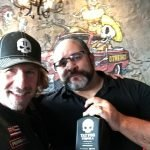 Tequila John and a fan holding a bottle of Tattoo Tequila